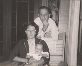 Joseph Cole Putnam and wife Virginia Perry Putnam holding their youngest, circa. 1959