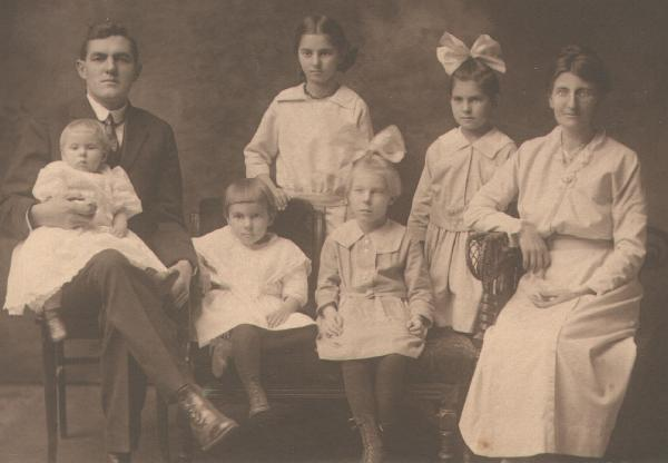 Erwin G. Poile Family, circa. 1920 - My mom, named Laura Marie Poile, is sitting with the bow in her hair. Her mother was Mary Louise Cronk, granddaughter of Hiram Cronk, last surviving veteran of the War of 1812