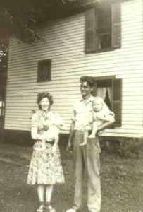 Albert Leroy and Laura Poile Cole, holding brother Glen and I in Camden, circa. 1945